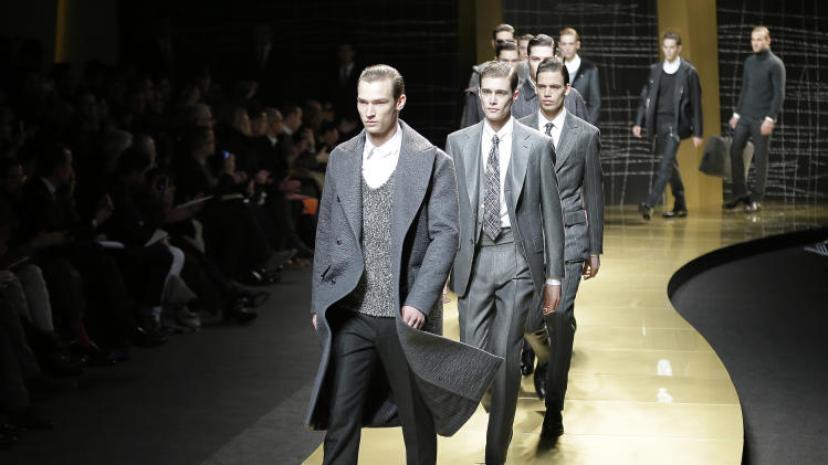 Models wear creations of Ermenegildo Zegna men's Fall-Winter 2013-14 collection, part of the Milan Fashion Week, unveiled in Milan, Italy, Saturday, Jan. 12, 2013. (AP Photo/Antonio Calanni)