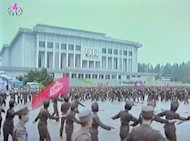 "A screen grab taken from North Korean TV on Wednesday shows North Korean soldiers dancing in a plaza after an announcement of North Korean leader Kim Jong-Un's new title of 'Marshal' in Pyongyang. North Korea said Friday it had no choice but to ""completely review"" the nuclear issue after accusing the United States and South Korea over a plot to blow up a statue of its founding leader"