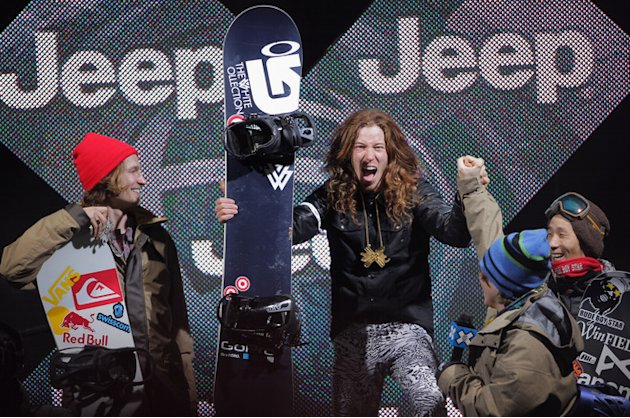Shaun White (C) Celebrates With Kevin Pearce (2R) As He Takes The Podium For The Goal Medal In The Men's Snowboard Getty Images