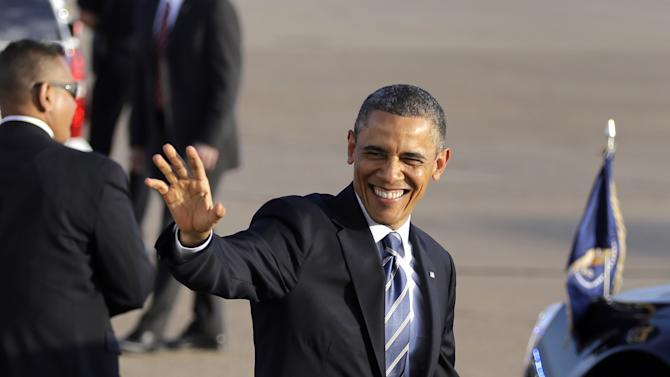 President Barack Obama waves to guest who were in attendance at his arrival at Love Field Wednesday, April 24, 2013, in Dallas. The President will be in attendance Thursday at the George W. Bush presidential library dedication. (AP Photo/Tony Gutierrez)