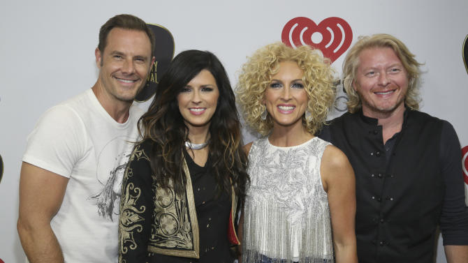 Little Big Town's Jimi Westbrook, Karen Fairchild, Kimberly Schlapman and Phillip Sweet, from left, arrive at the iHeartRadio Country Festival held at the Frank Erwin Center on Saturday, May 2, 2015 in Austin, Texas.. (Photo by [Jack Plunkett/Invision/AP)