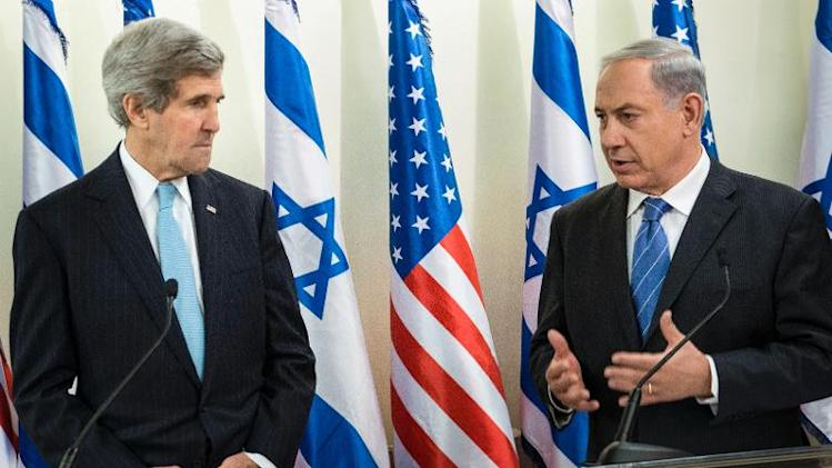 US Secretary of State John Kerry (L) listens as Israeli Prime Minister Benjamin Netanyahu makes a statement to the press before a meeting at the Prime Minister's Office on January 2, 2014 in Jerusalem