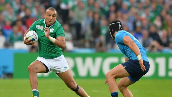 Ireland's full-back Simon Zebo (L) runs with the ball  during a Pool D match of the 2015 Rugby World Cup between Ireland and Italy at the Olympic Stadium, east London, on October 4, 2015