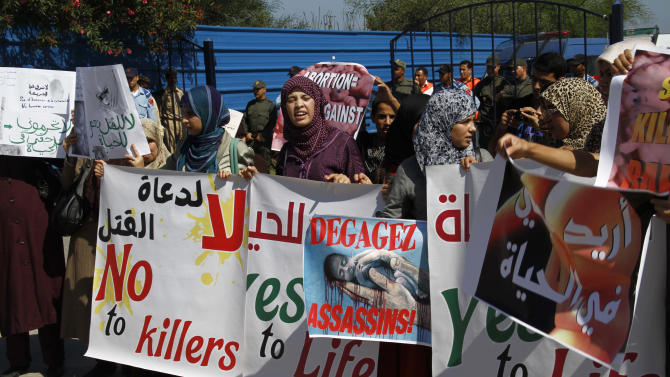 "Moroccan women protest the scheduled arrival of a Dutch ship advocating safe and legal abortions in Smir, Morocco Thursday oct 4 2012. Their signs read ""no to abortion."" Moroccan authorities sealed a port where a Dutch abortion ship was set to arrive , while demonstrators protested against its arrival . (AP Photo/Paul Schemm)."
