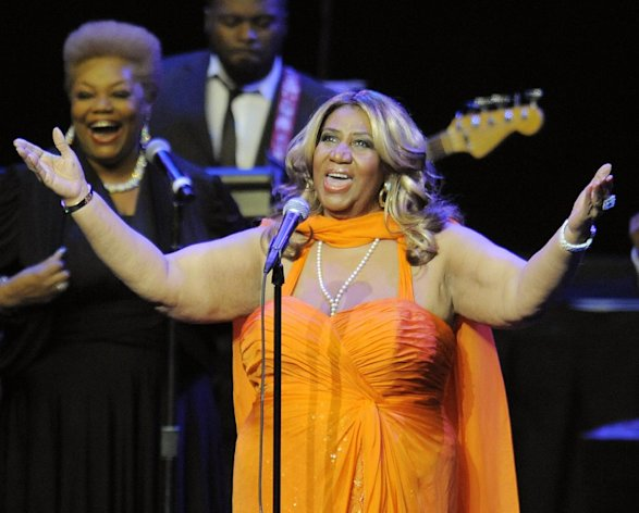 FILE - This July 25, 2012 file photo shows Aretha Franklin performing at the NOKIA Theatre L.A. LIVE in Los Angeles. Franklin sang for Mrs. Obama and Holder _ as well as for about 3,000 fans at DAR Constitution Hall on Saturday, Nov. 17. Afterward, Franklin said it was great to see her VIP guests relax and &quot;shake their hips a little,&quot; especially after a tough reelection campaign. (Photo by Chris Pizzello/Invision/AP, file)