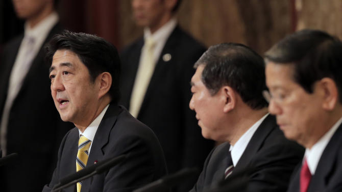 """In this Sept. 15, 2012 photo, Japan's leading opposition Liberal Democratic Party presidential candidate Shinzo Abe, left, as his rivals, Shigeru Ishiba, center, and Nobutaka Machimura, listen to him during a debate at the Japan National Press Club in Tokyo.  Former Prime Minister Abe blasted China at a press conference Wednesday, Sept. 18, 2012, after anti-Japanese riots flared across China. He says that if Beijing can't protect Japanese living in China it """"should not enjoy membership in the international society.""""   (AP Photo/Itsuo Inouye)"""