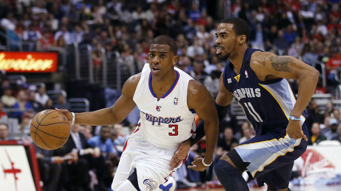 Los Angeles Clippers' Chris Paul (3) drives past Memphis Grizzlies' Mike Conley during the first half of an NBA basketball game in Los Angeles, Wednesday, March 13, 2013. (AP Photo/Jae C. Hong)