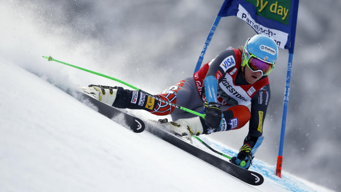 Ted Ligety, of the United States, passes a gate during the first run of an alpine ski, men's world cup giant slalom in Garmisch-Partenkirchen, Germany, Sunday, Feb. 24, 2013. (AP Photo/Shinichiro Tanaka)