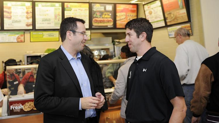 "IMAGE DISTRIBUTED FOR SUBWAY - Jared ""The SUBWAY Guy"" Fogle, left, talks with Ryan Kules, alumni director for Wounded Warrior Project, at a SUBWAY cafe at the Navy Exchange, Saturday, Nov. 10, 2012 in Bethesda, Md. SUBWAY restaurants donated $111,112.00 to Wounded Warrior Project. Kules is an Army veteran who served and was wounded in Iraq in 2005. (Photo by Nick Wass/Invision for SUBWAY/AP Images)"