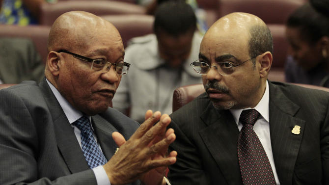 South African President Jacob Zuma, left, talks with Ethiopian Prime Minister Meles Zenawi as they await the start of a session on climate change, at the Sipopo conference center, outside Malabo, Equatorial Guinea, Wednesday, June 29, 2011. African heads of state were arriving in the tiny, oil-rich central African nation Wednesday ahead of the start of the 17th African Union Summit, which opens Thursday in a specially-built luxury complex outside Malabo. (AP Photo/Rebecca Blackwell)