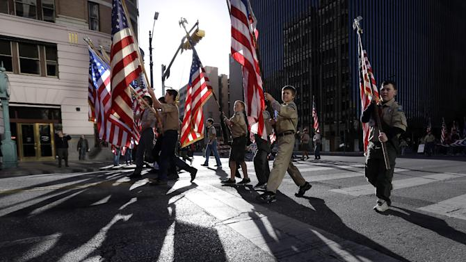 Boy Scouts carry U.S. flags up Congress Avenue towards the Texas Capitol during the annual Boy Scouts Parade and Report to State, Saturday, Feb. 2, 2013, in Austin, Texas. Gov. Rick Perry says he hopes the Boy Scouts of America doesn't move soften its mandatory no-gays membership policy. (AP Photo/Eric Gay)