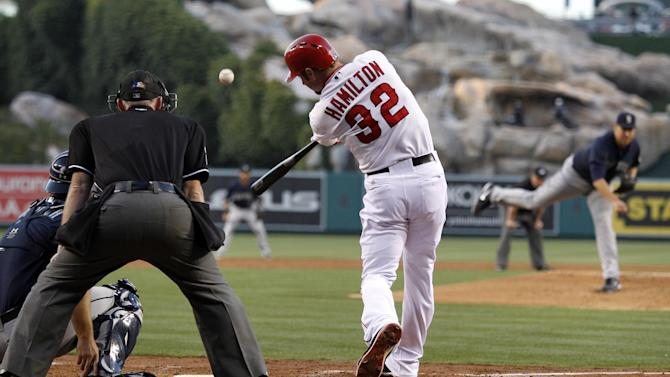 Los Angeles Angels' Josh Hamilton (32) hits a two-run home run against Seattle Mariners starting pitcher Aaron Harang, right, in the first inning during a baseball game Tuesday, May 21, 2013 in Anaheim.    (AP Photo/Alex Gallardo)