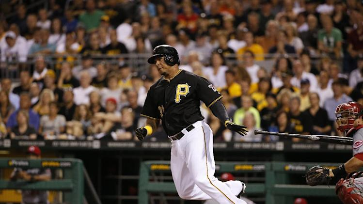 Pittsburgh Pirates' Jose Tabata drives in a run with a single off Cincinnati Reds relief pitcher Jonathan Broxton during the eighth inning of a baseball game in Pittsburgh Friday, Aug. 29, 2014. The Pirates won 2-1. (AP Photo/Gene J. Puskar)