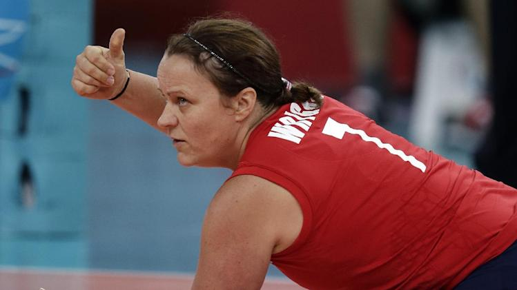 Martine Wright of Britain gestures as she plays the Ukraine, during their women' sitting volleyball match at the 2012 Paralympics games, Friday, Aug. 31, 2012, in London. On July 7, 2005, four suicide bombers detonated explosives on London's transit system, killing 52 commuters and the four attackers. Wright was among the injured on 7/7, losing both her legs. Seven years later, she's been transformed into an athlete, a Paralympian.(AP Photo/Alastair Grant)