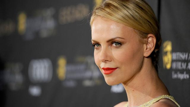 Charlize Theron Recalls Childhood with No Teeth