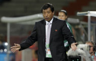 North Korea team coach Kim Kwang Min reacts during the group C match between North Korea and Colombia at the Women's Soccer World Cup in Bochum, Germany, Wednesday, July 6, 2011. (AP Photo/Yves Logghe)