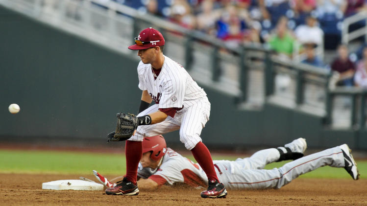 Arkansas' Dominic Ficociello, rear, steals second base against South Carolina second baseman Chase Vergason in the first inning of an NCAA College World Series baseball game in Omaha, Neb., Monday, June 18, 2012. (AP Photo/Eric Francis)