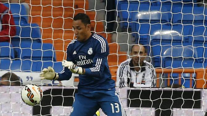 Real Madrid's goalkeeper Navas makes a save during their Spanish first division soccer match against Elche in Madrid