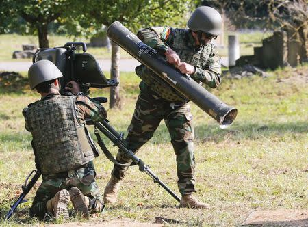 Peshmerga fighters dismantle a French-German anti-tank light infantry missile MILAN during a training session at the Bundeswehr army infantry school of Hammelburg