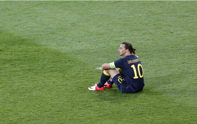 Sweden's Zlatan Ibrahimovic sits on the pitch during the Euro 2012 soccer championship Group D match between Ukraine and Sweden in Kiev, Ukraine, Monday, June 11, 2012. (AP Photo/Darko Vojinovic)