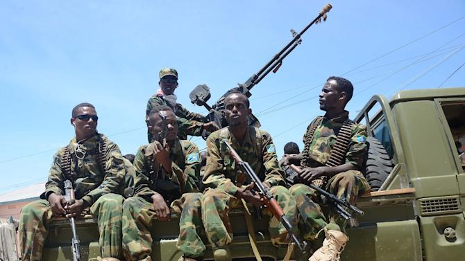 Somali soldiers patrol in Wadajir district south of the capital following heavy fighting as Somali government and African Union troops battled a powerful militia warlord in a bid to disarm him in Mogadishu on August 15, 2014