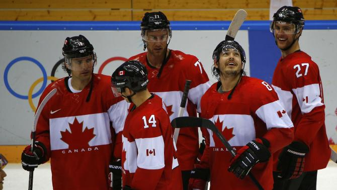 Canada's Doughty reacts with teammates Sharp, Carter, Kunitz and Pietrangelo after his game winning overtime goal against Finland during their men's preliminary round ice hockey game at the Sochi 2014 Winter Olympic Games