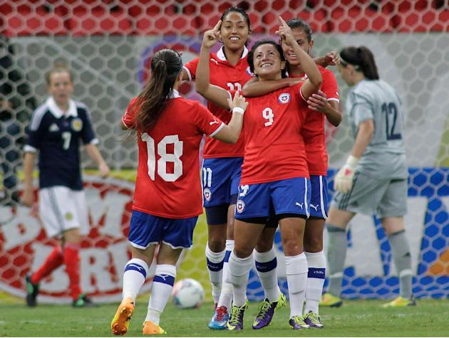 Chile's Maria Rojas Pino (9) celebrates with teammates after scoring against Scotland during a soccer match at the International Women's Football Tournament in Brasilia, Brazil, Wednesday, Dec