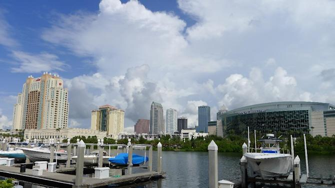 This photo taken Monday, Aug. 13, 2012 shows the downtown Tampa, Fla. The Tampa Bay Times Forum, right, is the location of the Republican National Convention, which will be held Aug. 27-30. Traffic caused by road closures and protests are a concern of downtown workers and residents. (AP Photo/Tamara Lush)
