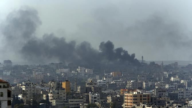 Smoke from Israeli strikes rise over Gaza City, northern Gaza Strip, Monday, July 21, 2014. The first major ground battle in two weeks of Israel-Hamas fighting exacted a steep price Sunday: It killed 65 Palestinians and 13 Israeli soldiers and forced thousands of terrified Palestinian civilians to flee Gaza City's Shijaiyah neighborhood, reportedly used to launch rockets at Israel and now devastated by the fighting. (AP Photo/Lefteris Pitarakis)