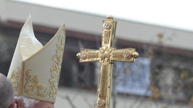 Pope Benedict XVI is cheered by faithful as he arrives at the St. Patrick parish church to celebrate a mass in Rome, Sunday, Dec. 16, 2012. (AP Photo/Gregorio Borgia)