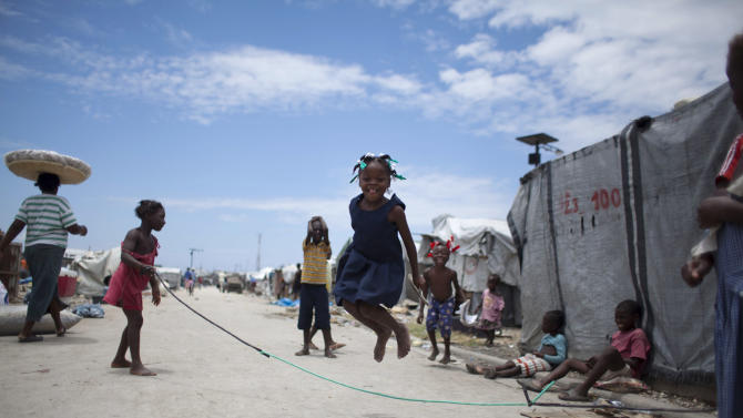 A young girl jumps rope inside the Jean-Marie Vincent camp for people displaced by the 2010 earthquake in Port-au-Prince, Haiti, Monday, April 22, 2013. The number of people still living in camps has become a barometer of the success or failure of how to house Haitians, though it's unclear what happens to most people after they leave the formal camps. (AP Photo/Dieu Nalio Chery)