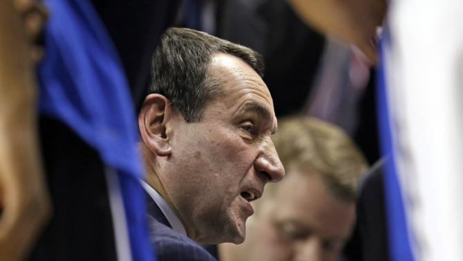 FILE - In this March 15, 2013, file photo, Duke head coach Mike Krzyzewski talks to his team during the first half of an NCAA college basketball game against Maryland at the Atlantic Coast Conference tournament in Greensboro, N.C. Duke has learned its lesson. No more looking deep into the bracket at a possible rematch with Louisville. Not after a surprising one-and-done last week at the ACC tournament exposed some of the same warts that popped up in last year's shocking loss to 15th-seeded Lehigh in the NCAA tournament. (AP Photo/Gerry Broome, File)