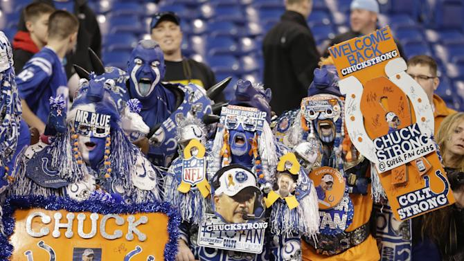 Indianapolis Colts fans welcome head coach Chuck Pagano to the field before an NFL football game against the Houston Texans, Sunday, Dec. 30, 2012, in Indianapolis. Pagano is back as coach after nearly three months of treatments for leukemia. (AP Photo/Michael Conroy)