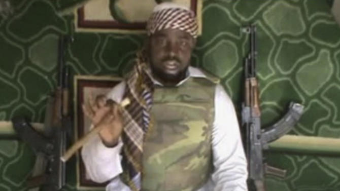 FILE: This file image made available from Wednesday, Jan. 10, 2012, taken from video posted by Boko Haram sympathizers shows the leader of the radical Islamist sect Imam Abubakar Shekau. Shaking a finger while cradling an assault rifle, the bearded leader of Nigeria's extremist Islamic sect Abubakar Shekau threaten in a video on Saturday July 13, 2013 to burn down more schools and kill teachers. But he denies his fighters are killing children. (AP Photo, FIle ) THE ASSOCIATED PRESS CANNOT INDEPENDENTLY VERIFY THE CONTENT, DATE, LOCATION OR AUTHENTICITY OF THIS MATERIAL