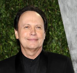 "FILE - In this Feb. 26, 2012 file photo, actor Billy Crystal arriving at the Vanity Fair Oscar party in West Hollywood, Calif. Crystal, who already donated $1 million to help Long Beach, N.Y., rebuild after Superstorm Sandy, has donated his time to appear in a TV ad that trumpets ""Long Beach is Open for Business."" Crystal is a 1965 graduate of Long Beach High School. (AP Photo/Evan Agostini, File)"