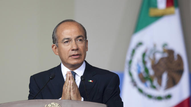 Mexico's President Felipe Calderon delivers his state-of-the-nation address to Congress in Mexico City, Monday, Sept. 3, 2012.  Calderon delivered his final state-of-the-nation speech on Monday, trying to cement his legacy as the president who stabilized the economy and took on the country's entrenched organized crime groups, putting Mexico on the road to rule of law.  (AP Photo/Alexandre Meneghini)