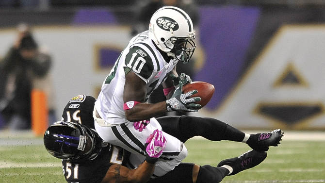 Baltimore Ravens linebacker Brendon Ayanbadejo (51) tackles New York Jets wide receiver Santonio Holmes during the first half of an NFL football game in Baltimore, Sunday, Oct. 2, 2011. (AP Photo/Gail Burton)