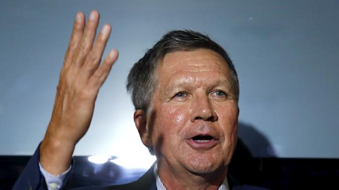 Republican Ohio Governor John Kasich speaks at a news conference