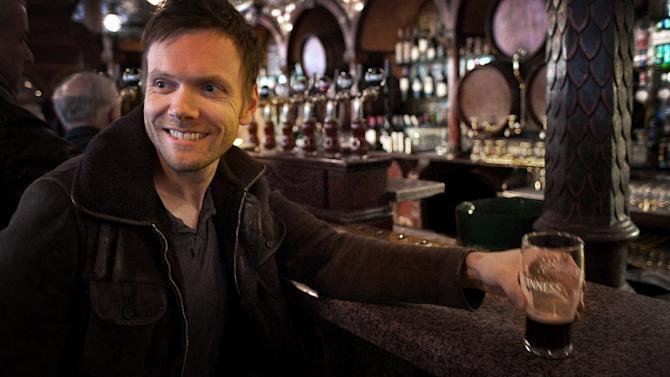 """This publicity image released by Esquire Network shows host Joel McHale at a pub in Belfast, Ireland, in a scene from the series """"The Getaway."""" NBC Universal on Wednesday announced the rebranded Esquire Network. The channel is the namesake of Esquire magazine and is aiming to draw a similar audience of upscale males. NBCUniversal and Hearst Magazines are the partners behind the Esquire Network, which is a NBCUniversal Cable Entertainment unit.  (AP Photo/Esquire Network)"""