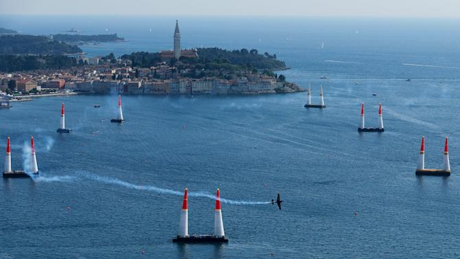 An aircraft flies through the course during the qualifying race at the Red Bull Air Race World Championship in Rovinj