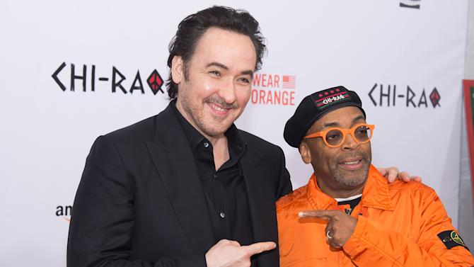 "John Cusack, left, and Spike Lee attend the premiere of ""Chi-Raq"" at the Ziegfeld Theatre on Tuesday, Dec. 1, 2015, in New York. (Photo by Charles Sykes/Invision/AP)"