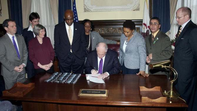 In this photo provided by the Illinois Information Service, Illinois Gov. Pat Quinn signs legislation to abolish the state's death penalty Wednesday, March 9, 2011 at his office in Springfield, Ill. Quinn's signing came more than a decade after the state imposed a moratorium on executions out of concern that innocent people could be put to death by a justice system that had wrongly condemned 13 men. (AP Photo/Illinois Information Service, Randy Squires)