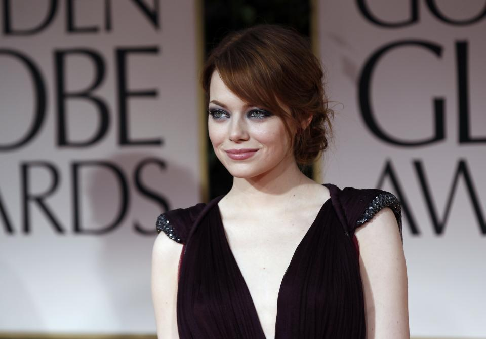 Emma Stone arrives at the 69th Annual Golden Globe Awards Sunday, Jan. 15, 2012, in Los Angeles. (AP Photo/Matt Sayles)