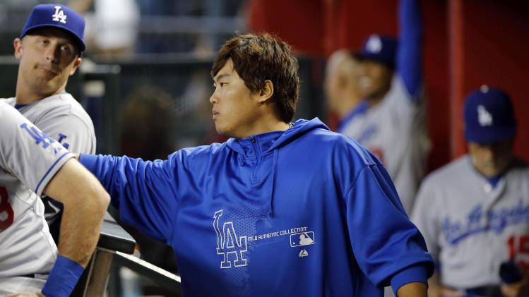 Los Angeles Dodgers pitcher Hyun-Jin Ryu greets teammates prior to a baseball game against the Arizona Diamondbacks, Tuesday, July 9, 2013, in Phoenix. (AP Photo/Matt York)