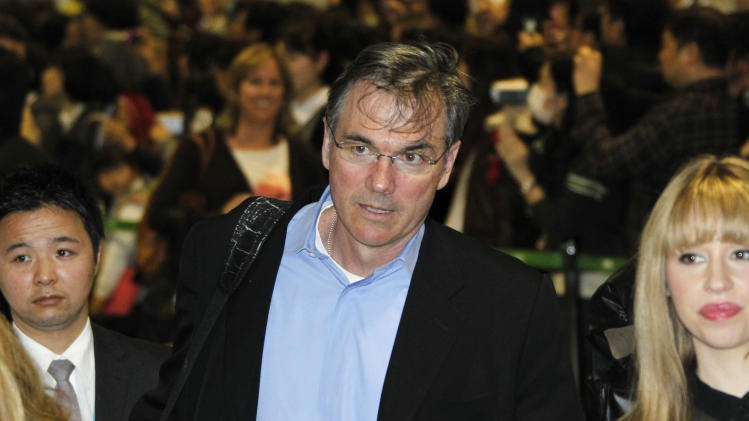 Oakland Athletics General Manager Billy Beane arrives at Narita International Airport in Narita, east of Tokyo, Friday, March 23, 2012.  The Athletics will meet the Seattle Mariners in their two season-opening games of the Major League Baseball in Japan, at Tokyo Dome from Wednesday, March 28. (AP Photo/Koji Sasahara)