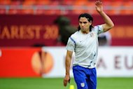 Atletico Madrid&#39;s Colombian forward Radamel Falcao stretches during a training session at the National Arena in Bucharest, on the eve of the UEFA Europa League final football match between Club Atletico Madrid and Athletic Club Bilbao