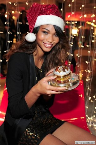 chanel iman holding dkny fragrance