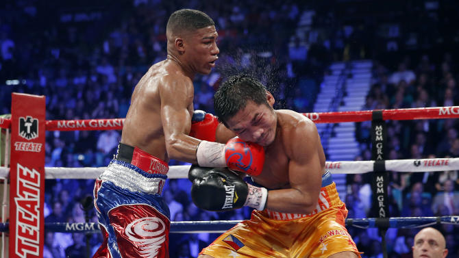Yuriorkis Gamboa, from Miami, Fla., left, connects against Michael Farenas, from the Philippines, during their WBA interim super featherweight title fight Saturday, Dec. 8, 2012, in Las Vegas. Gamboa went on to win the bout by unanimous decision. (AP Photo/Eric Jamison)