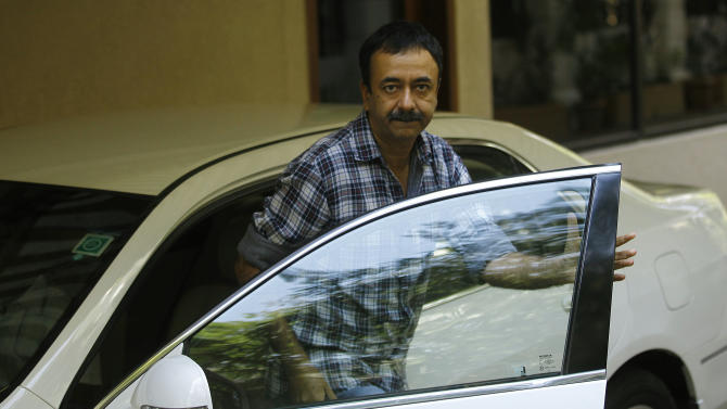 Bollywood director Rajkumar Hirani  arrives at the residence of actor Sanjay Dutt in Mumbai, India, Thursday, March 21, 2013. India's Supreme Court on Thursday upheld the weapons conviction of Dutt and ordered him to report to prison within four weeks in a case linked to the deadliest terror attack in Indian history.  Dutt's failed appeal of his conviction was part of a broader ruling by the Supreme Court on cases stemming from the 1993 bombings that killed 257 people in the financial hub of Mumbai.  (AP Photo/Rafiq Maqbool)