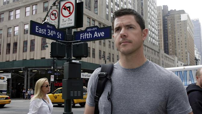 """In this photo taken on Thursday, June 12, 2014, former Army Sgt. Matthew Pelak poses for a photo on New York's Fifth Avenue. This week's stunning advance left many U.S. veterans reflecting, with bitterness, frustration and sadness, on the sacrifices of a war that lasted for more than eight years and killed nearly 4,500 Americans and tens of thousands of Iraqis. """"We removed the government, the standing army, any way for that country to organize itself,"""" said Pelak, who served in Iraq from 2004 to 2005 and later returned as a security contractor with the company then called Blackwater. """"So it's a bit tough to just say, 'Hey, let's all play nice in the sand box.'"""" (AP Photo/Richard Drew)"""